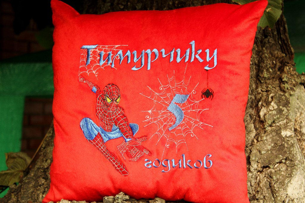 Red pillowcase with embroidered Spider-Man