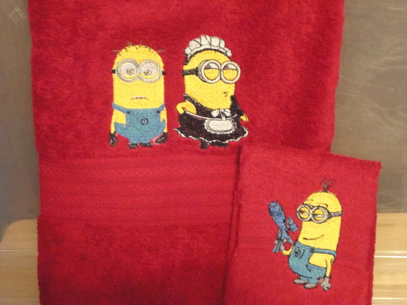 Despicable Me minions embroidered on red bath towel