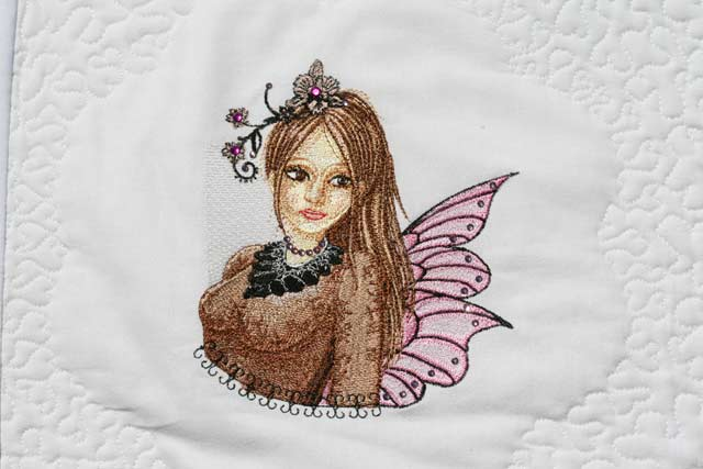 Modern fairy design on blanket embroidered