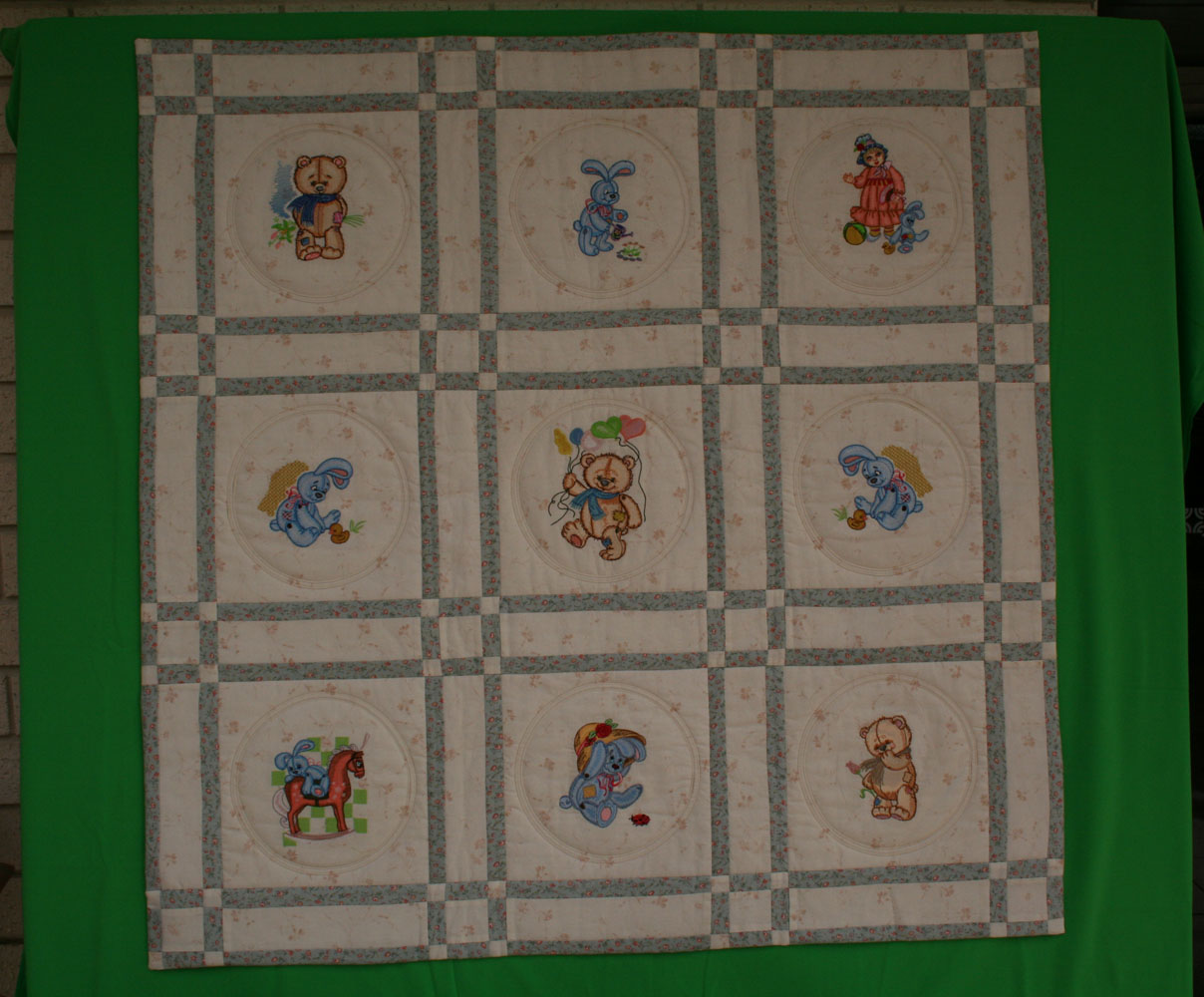 Quilt with old toys embroidery design