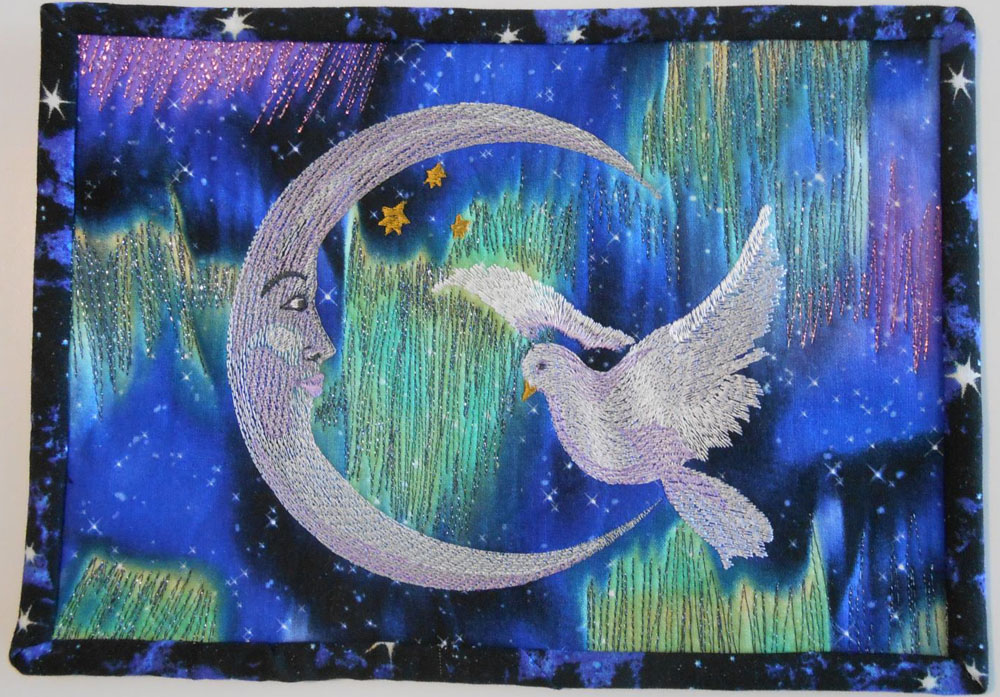 Crescent and dove in quilt embroidery