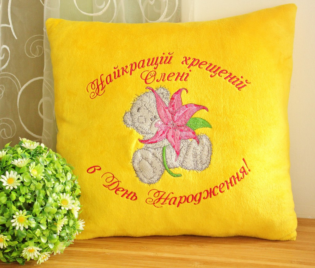 Yellow embroidered pillowcase with teddy bear design