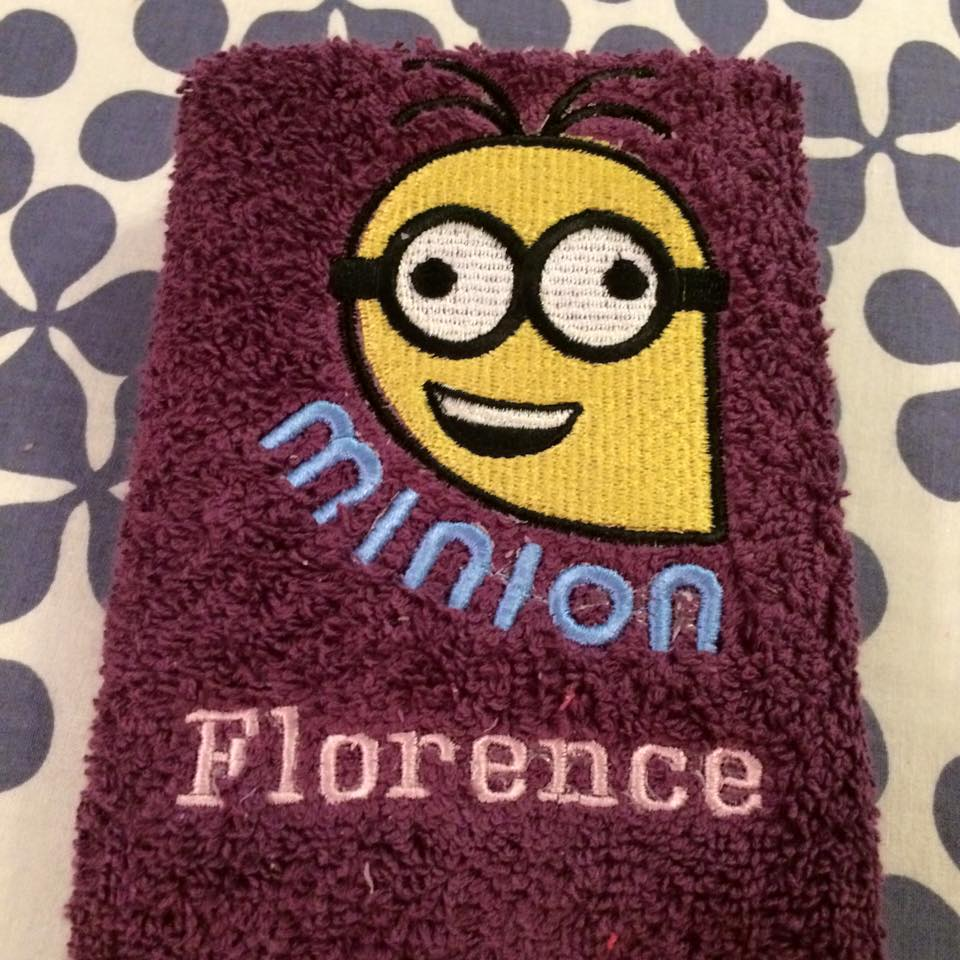 Crazy Minion on purple embroidered towel