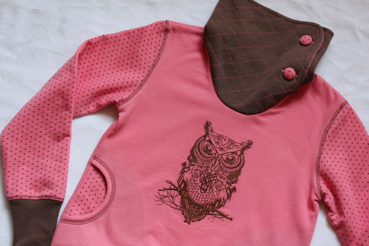 Tribal owl embroidered on sports wear