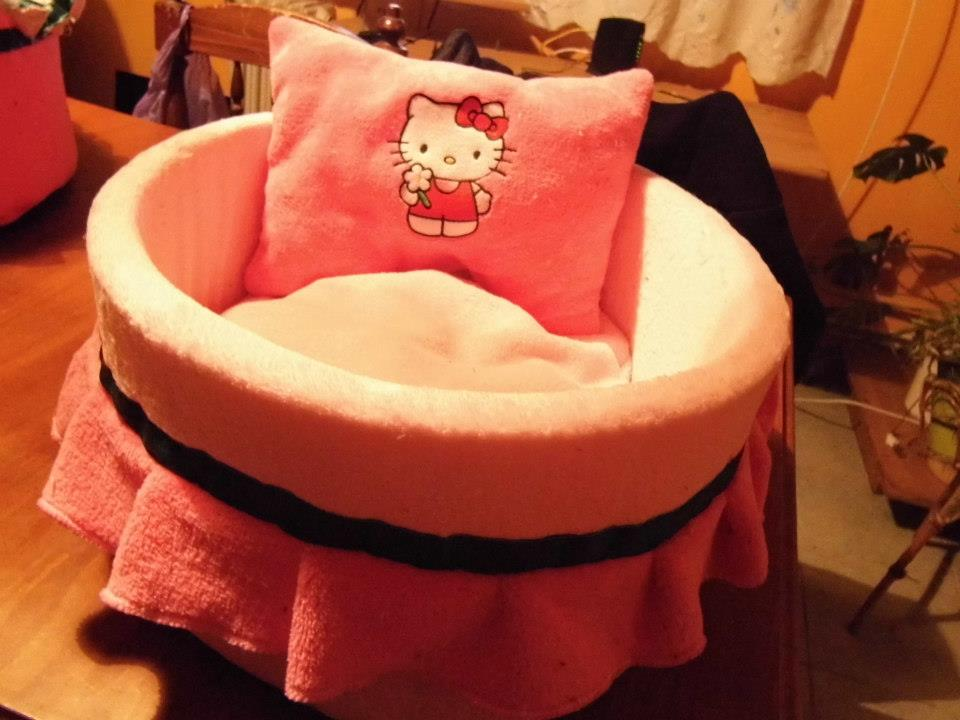 Embroidered pink pillowcase with Hello Kitty good day design on it