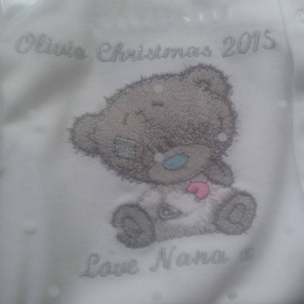 Embroidered bib with cute teddy bear on it