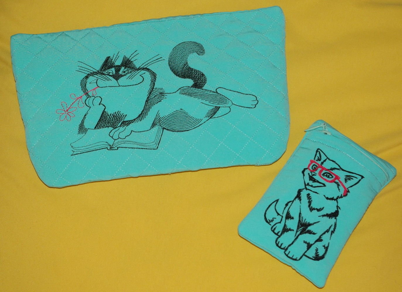 Green coin purses embroidered with cats