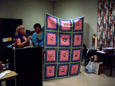 Embroidered quilt with Hello Kitty designs