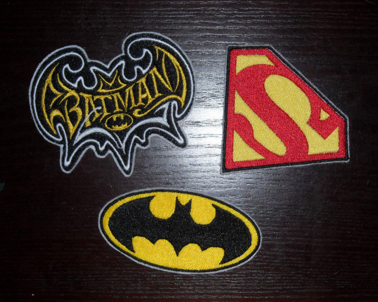 Superheroes logos embroidered