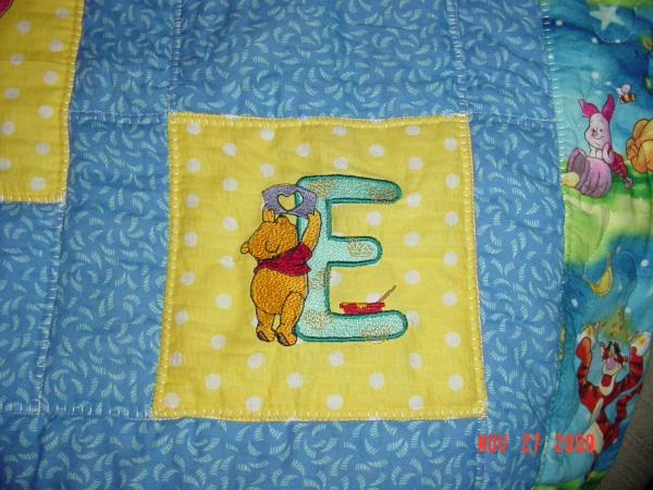 Winnie pooh letter E design on quilt embroidered