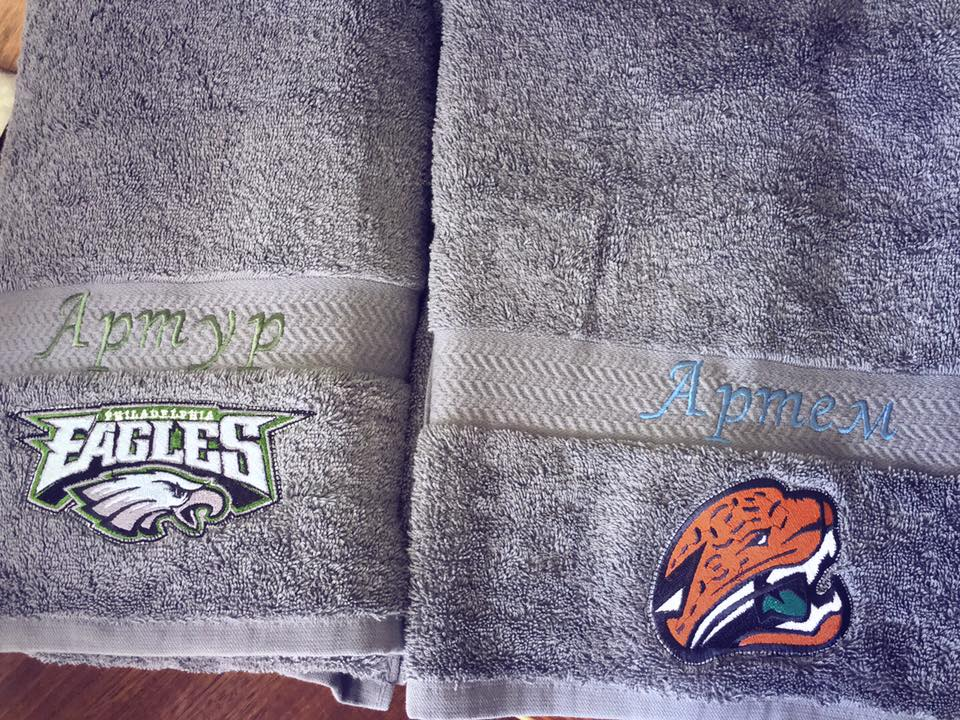 Bath towels with embroidered logos