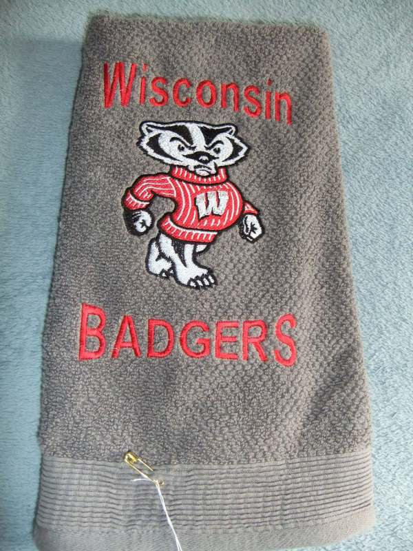 Towel with Bucky the badger machine embroidery design