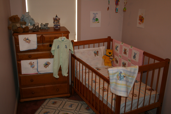 Baby room decorated with embroidered old toys designs