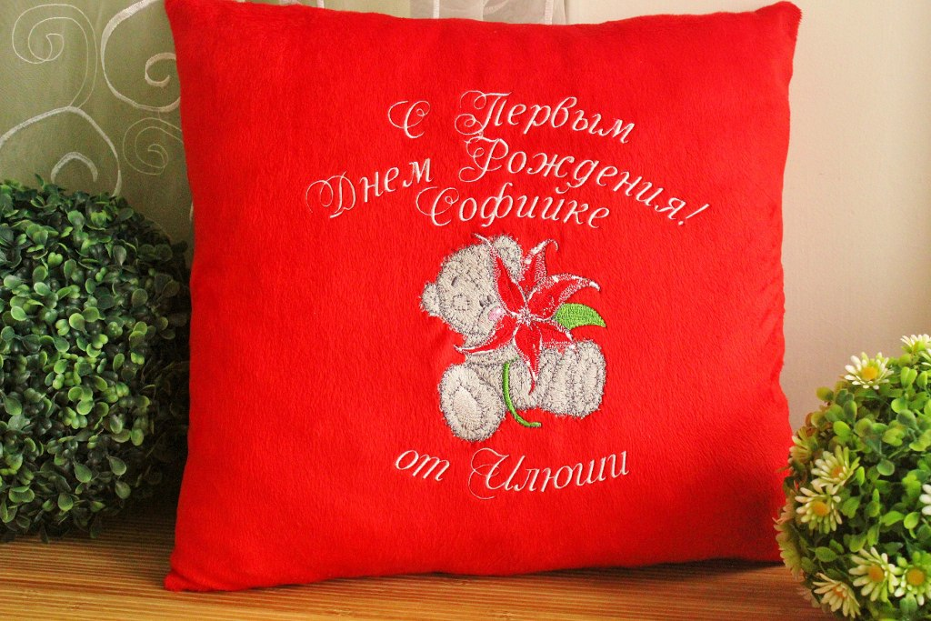 Red pillowcase embroidered with blue nose teddy bear