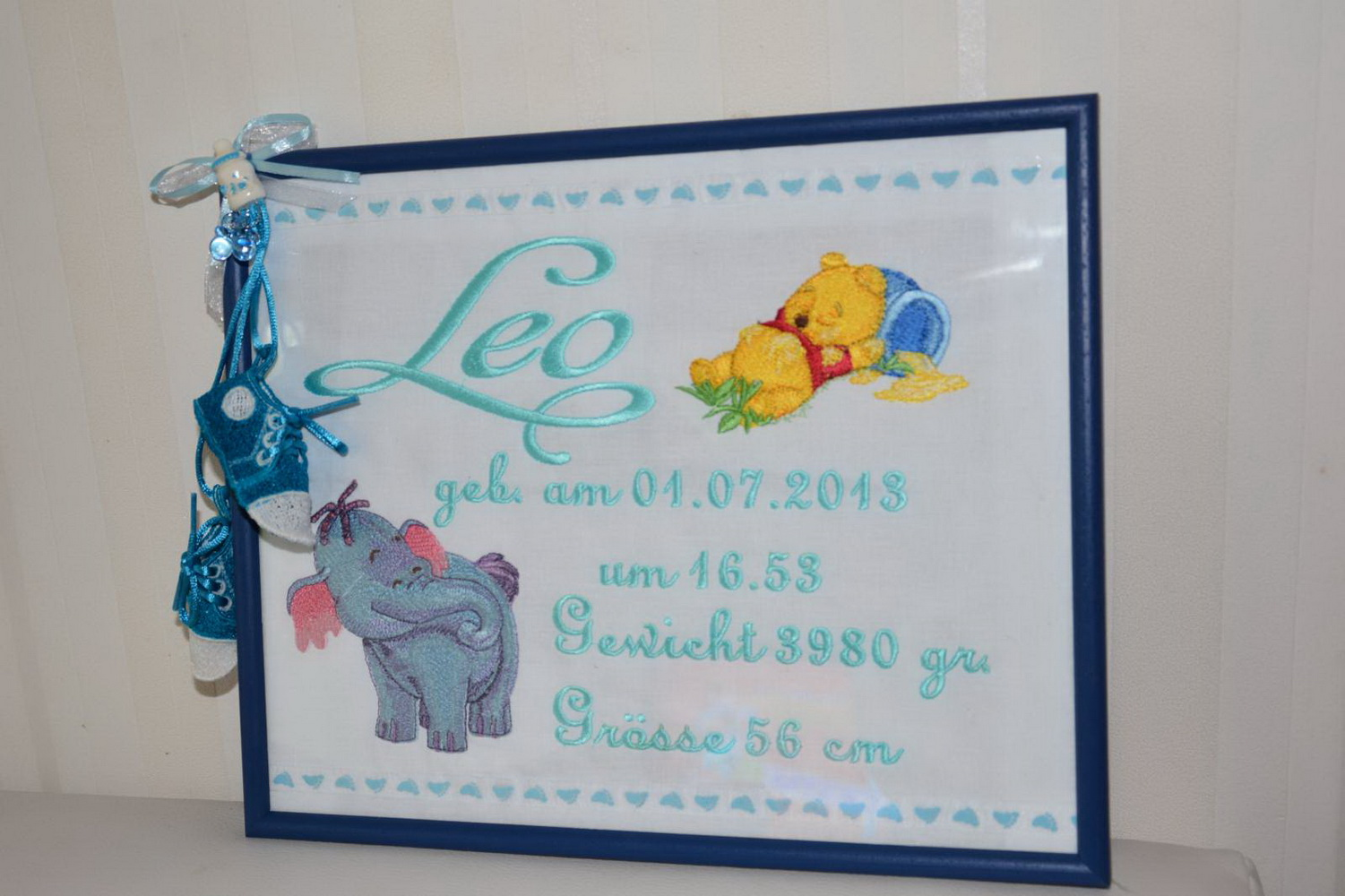 Winnie Pooh sleeping on honey pot and his friend on embroidered birthday frame