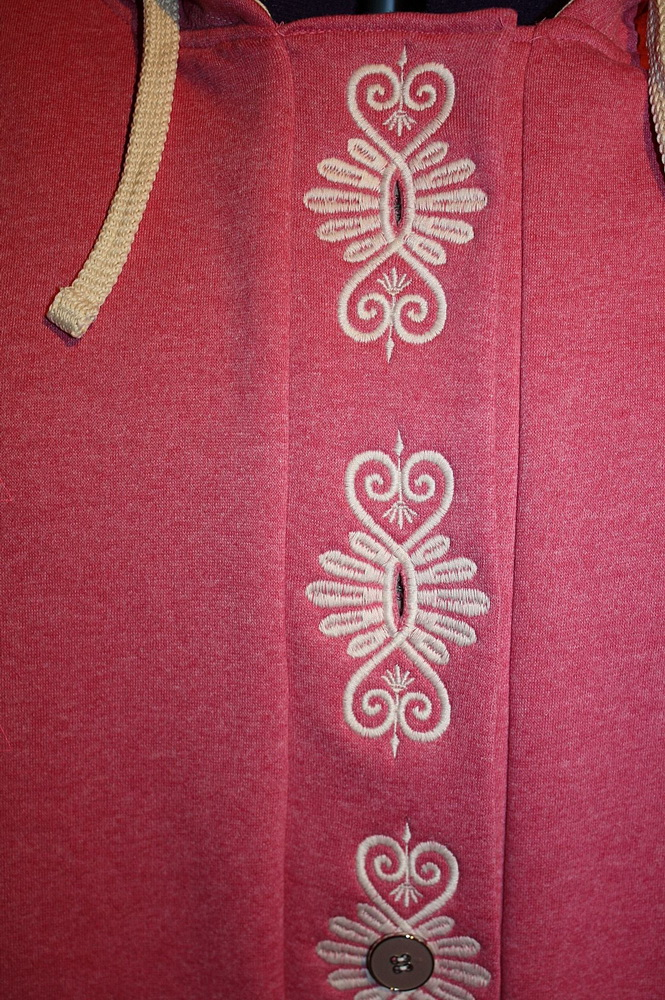Embroidered vignette design on jacket
