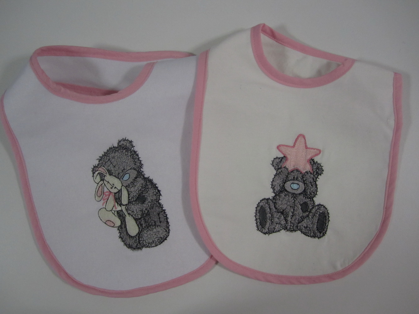 Embroidered Teddy bear designs on bibs