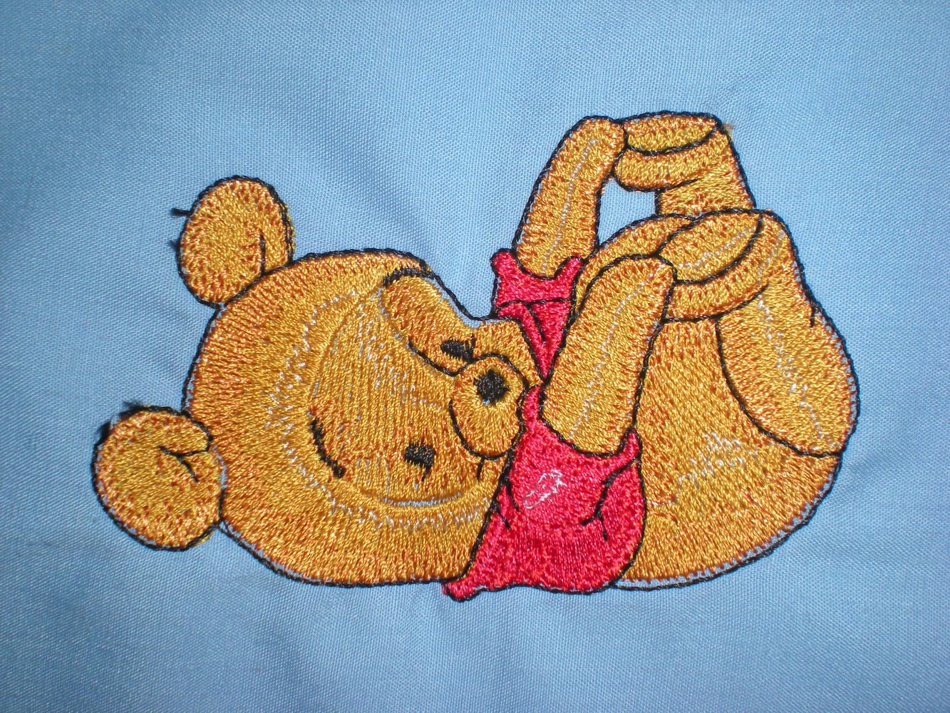 Baby Pooh design on bib embroidered