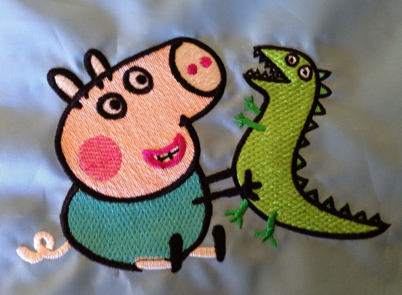 Peppa Pig with caterpillar design embroidered