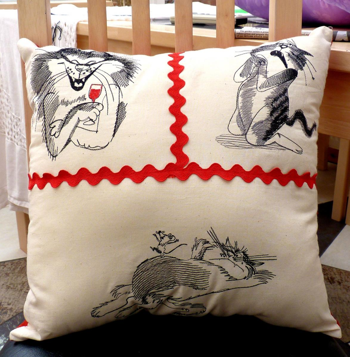 Embroidered pillow with free cats designs