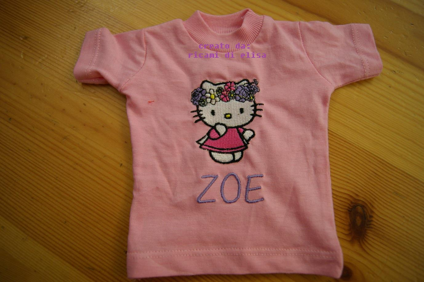Pink embroidered t-shirt with Hello Kitty Spring on it