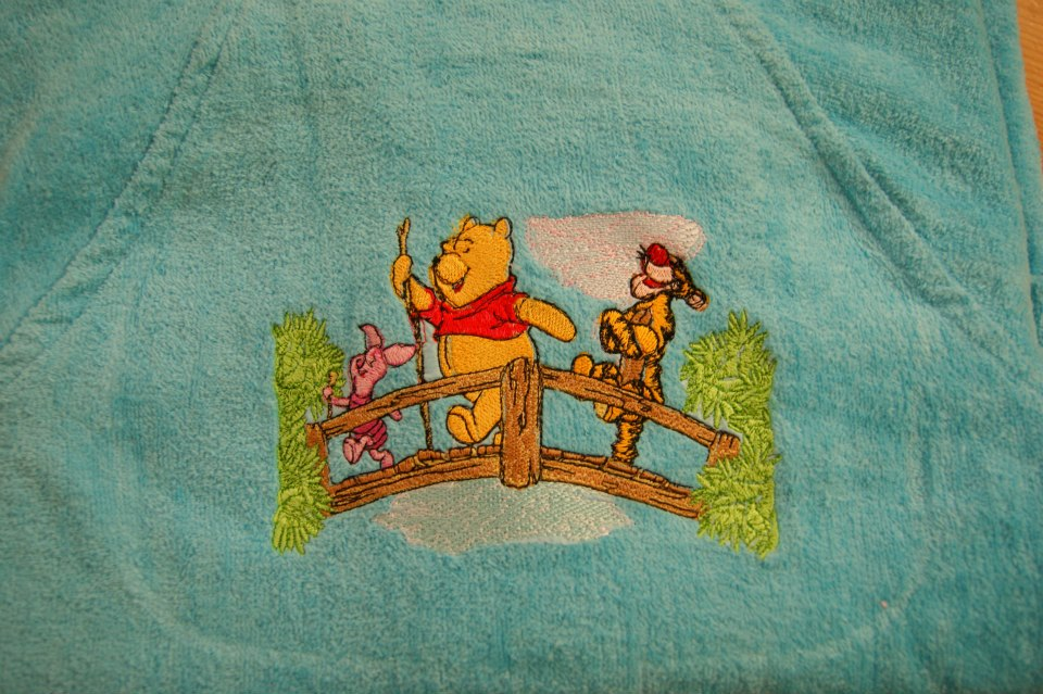 Embroidered Winnie Pooh, Tigger and Piglet on the bridge on bathrobe