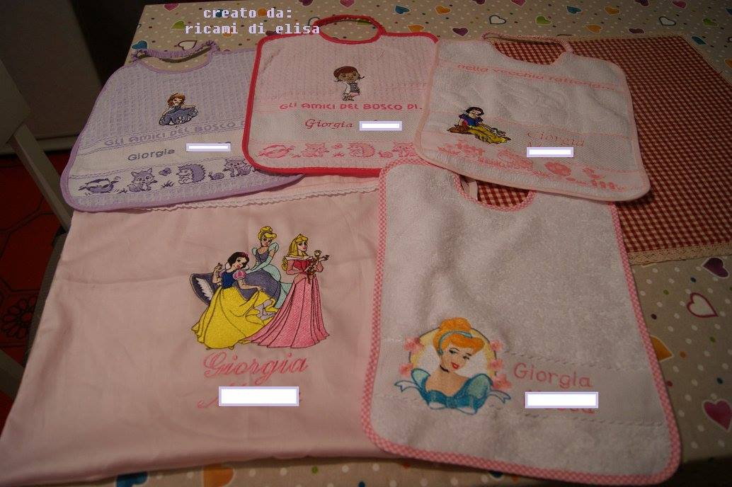 Disney princess designs and McSuffins embroidered on bibs and towel