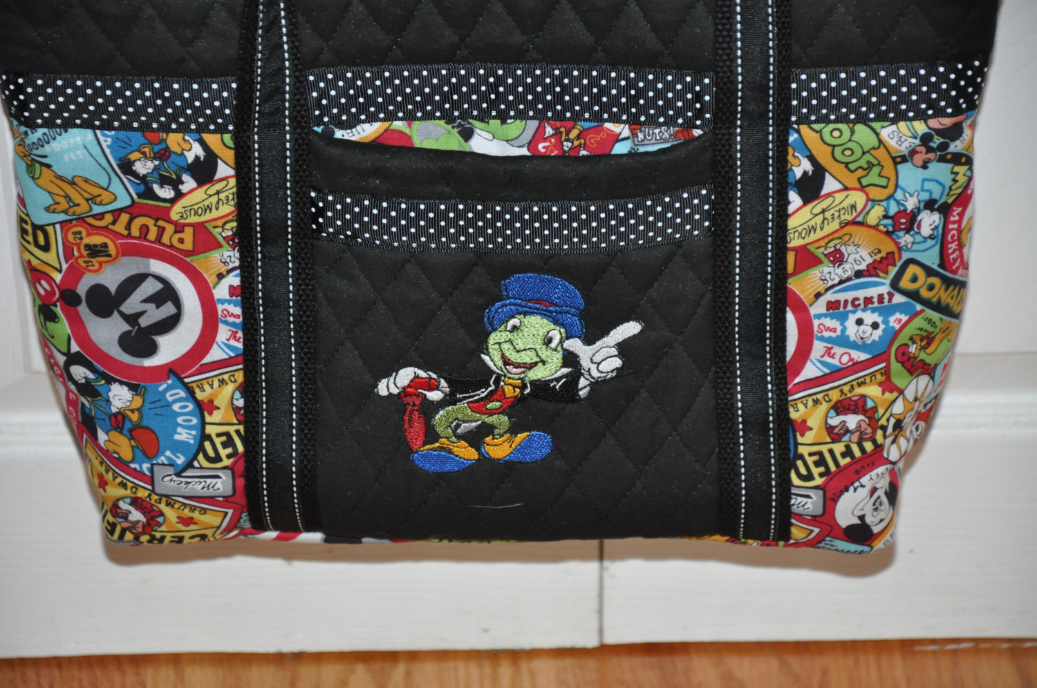 Jiminy Cricket design on bag embroidered