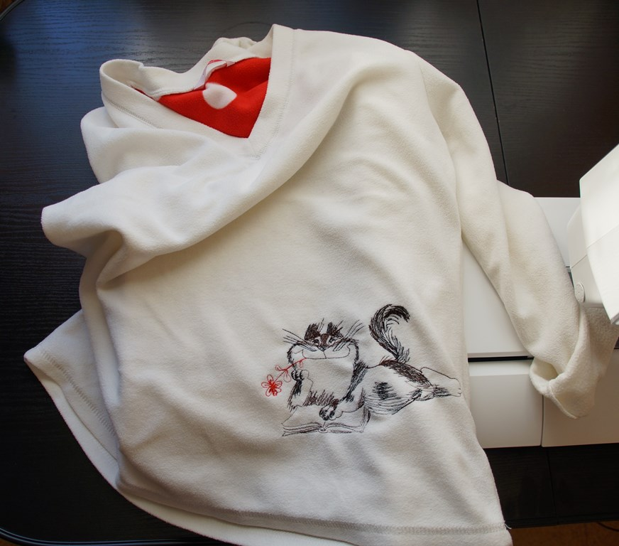 Cat with book embroidered on white hoodie