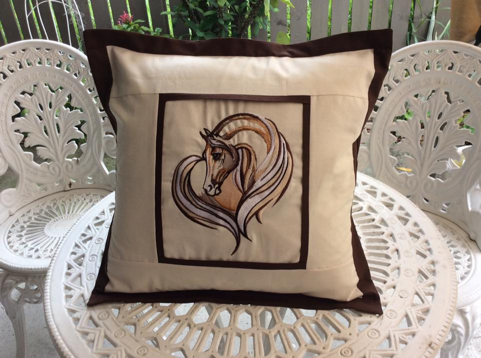 Horse heart embroidered on beige pillowcase