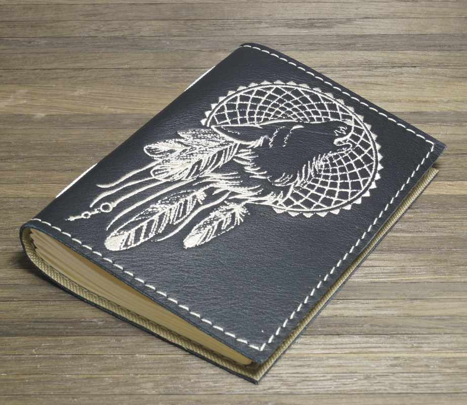 Leather cover with embroidered wolf dreamcatcher design