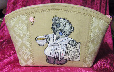 Teddy bear favorite tea and evening newspaper design on toilet bag embroidered