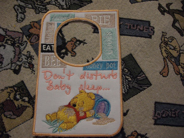 Sleep baby pooh design on Don't disturb sign embroidered