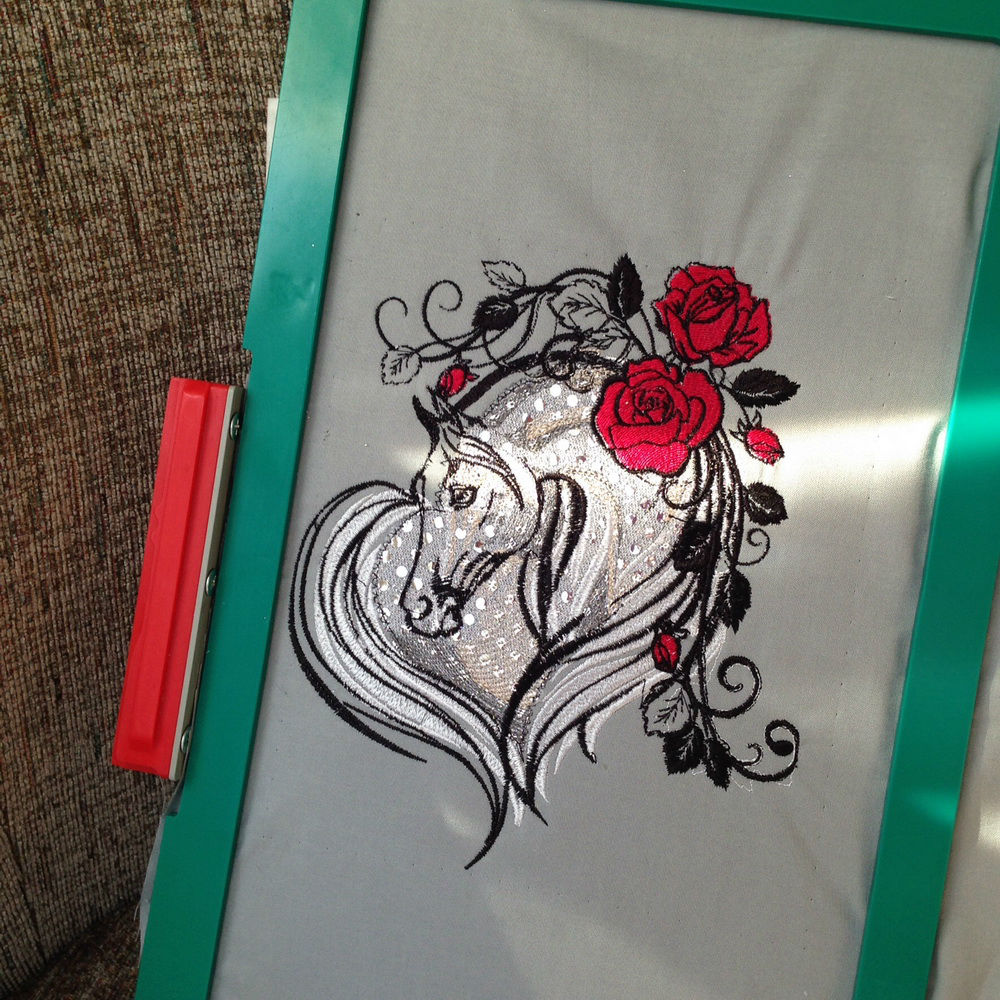 Rose and horse embroidered