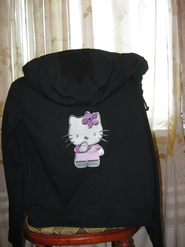 Embroidered Hello kitty I think design on jacket