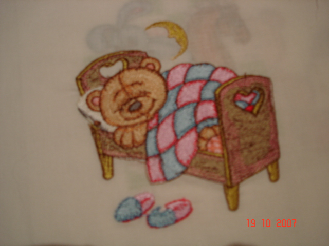 Teddy bear sleeping on bed design embroidered