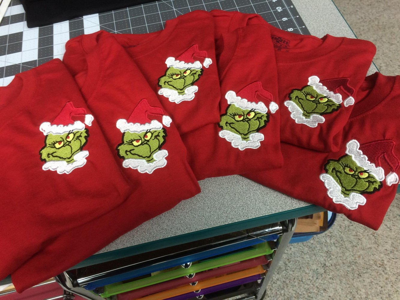 Grinch design on t-shirt embroidered