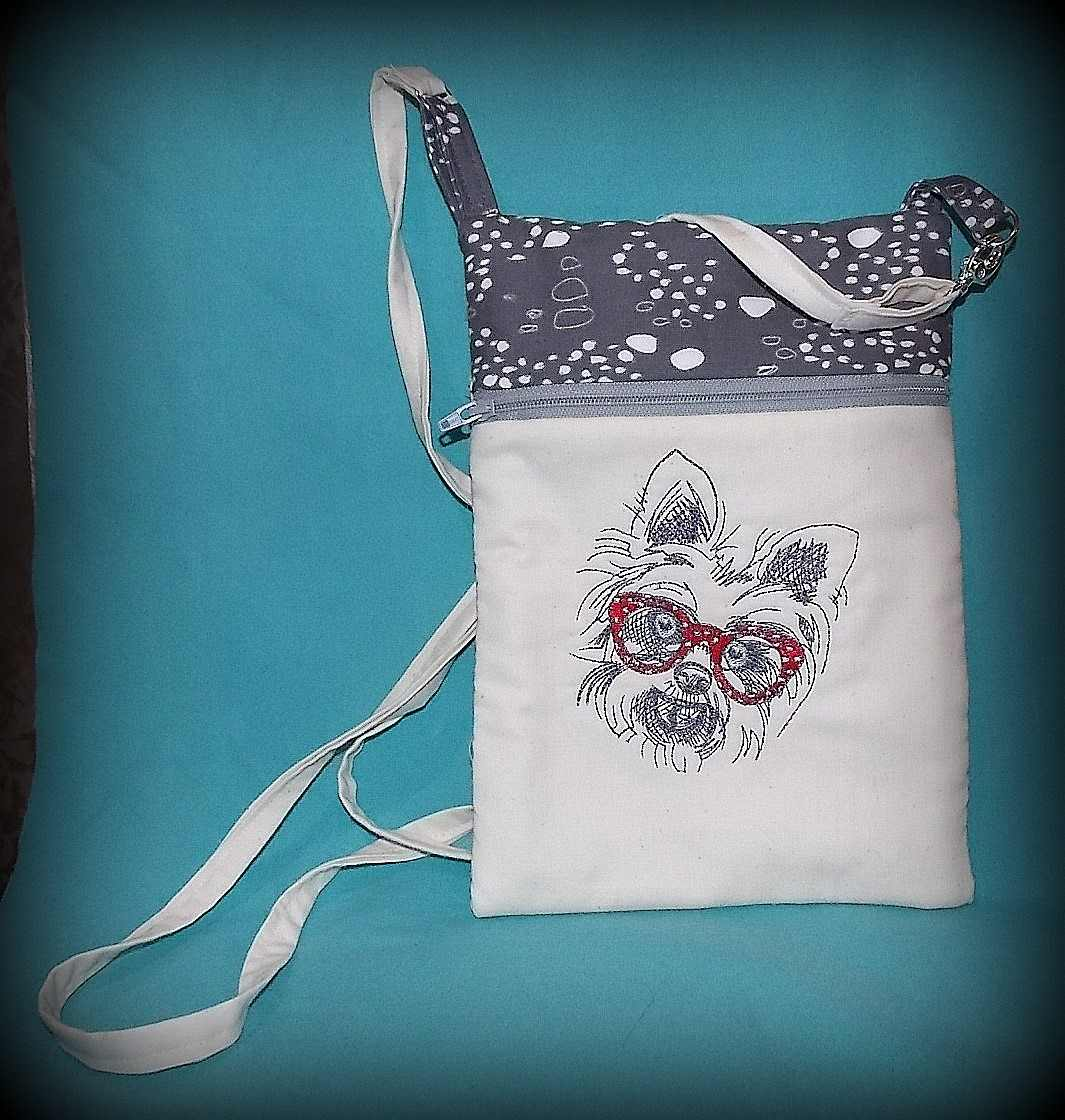 White terrier embroidery design on bag