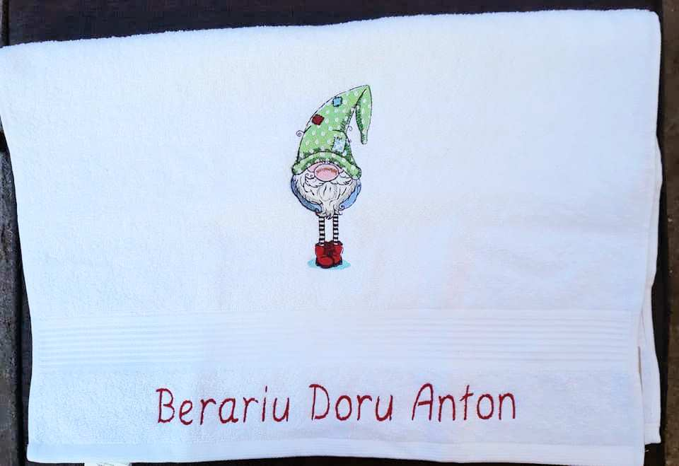 Bathroom towel with dwarf in green hat design
