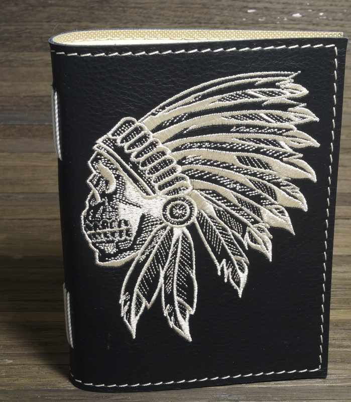 Embroidered leather cover with indian skull design