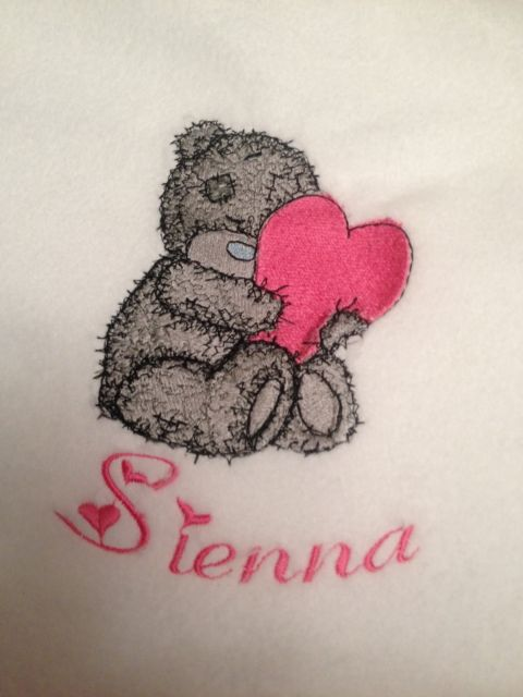 Teddy bear with a pillow heart design embroidered