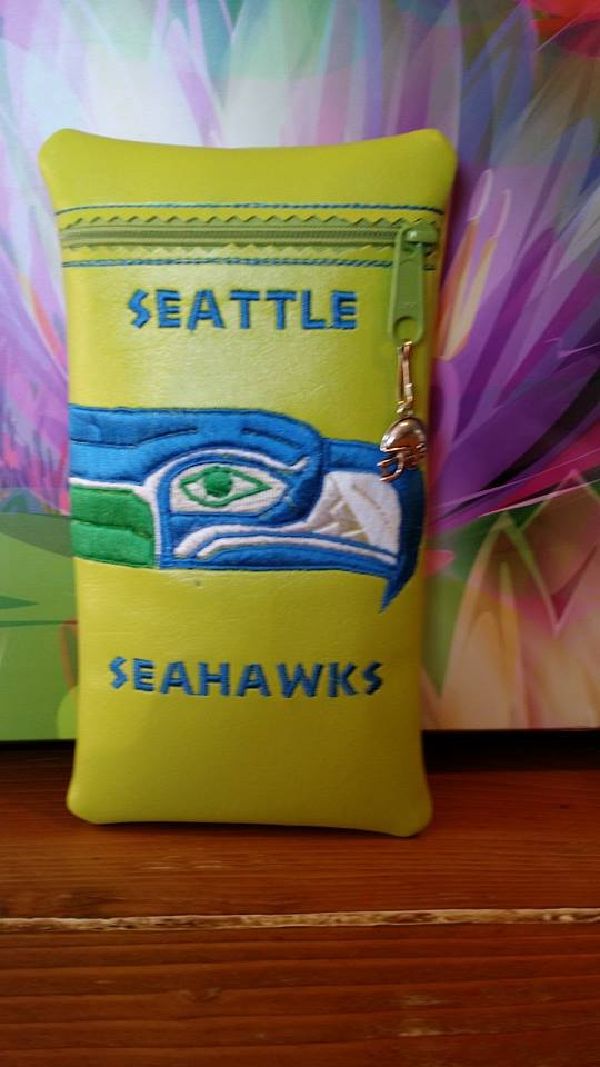 Embroidered Seattle Seahawks logo  on small leather bag