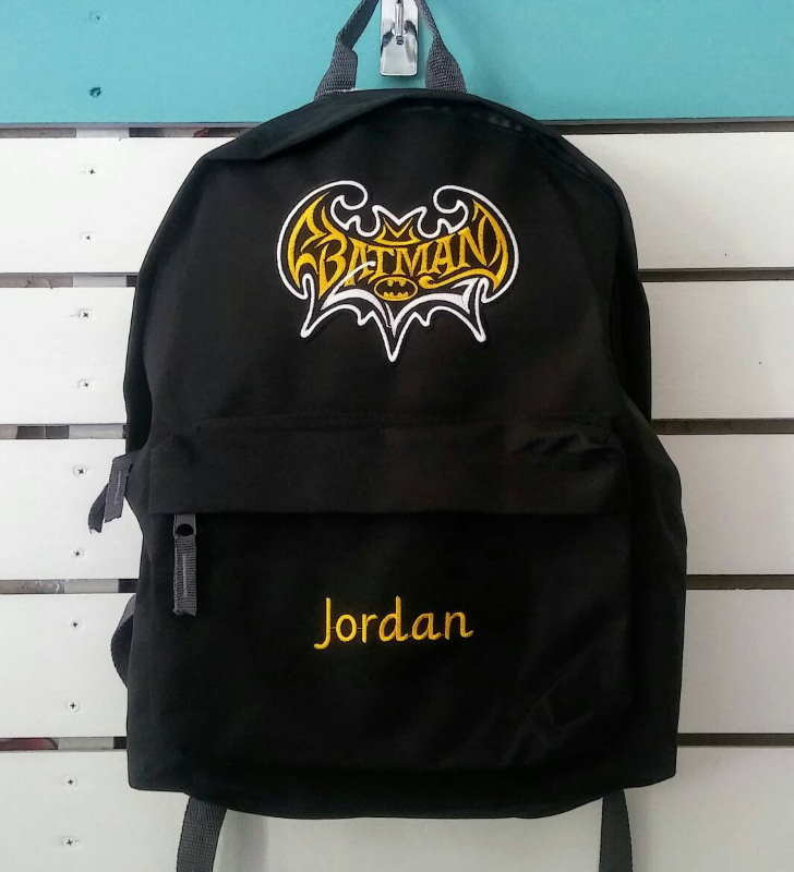 Embroidered backpack with batman vintage logo design
