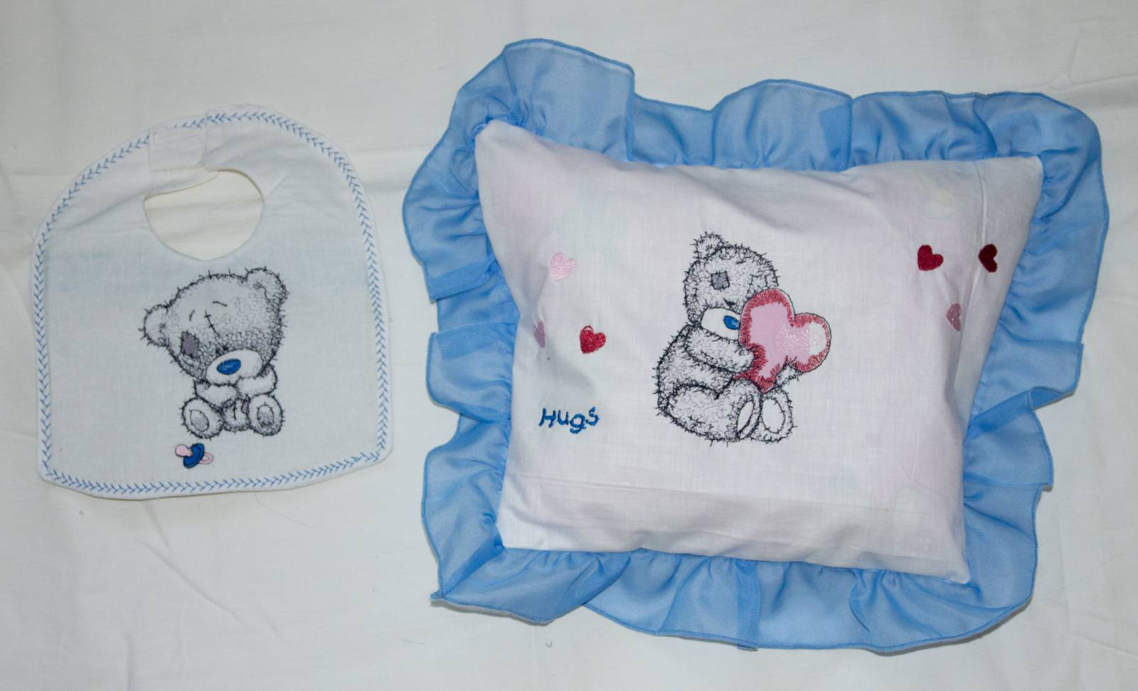 Blue nose bear embroidered on pillowcase and baby bib
