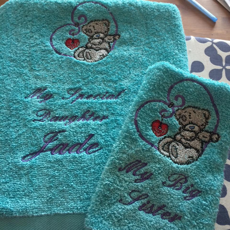Blue towel embroidered with blue nose teddy bear