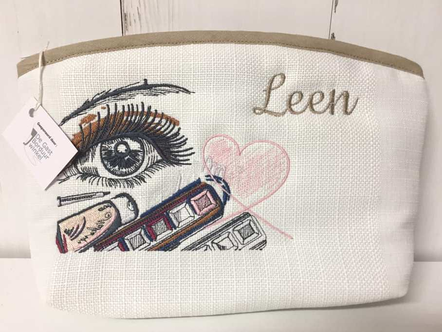 Embroidered cosmetic bag with make up design
