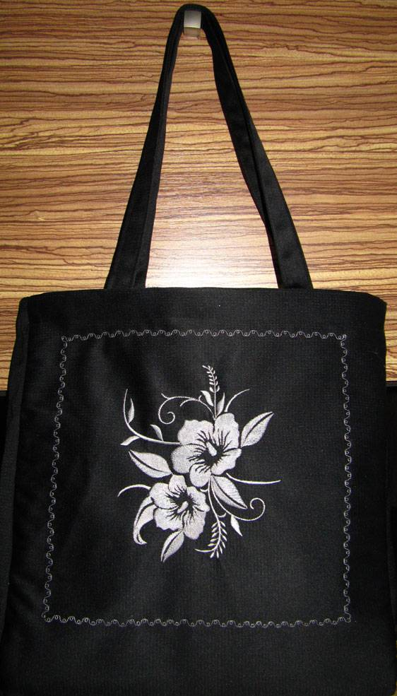 Black bag embroidered with flower