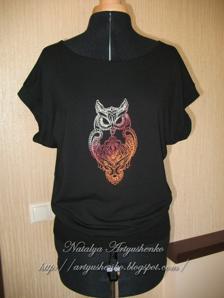 Embroidered owl on black blouse