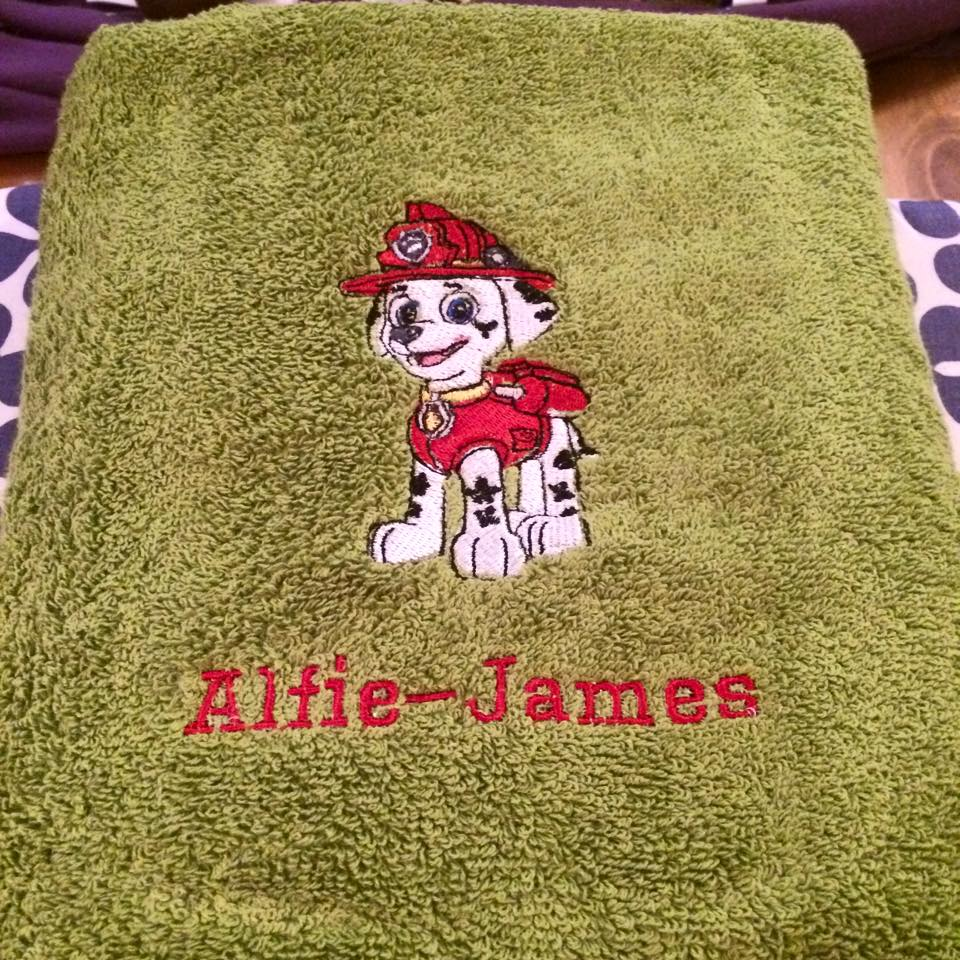 Cute brave dog on embroidered towel