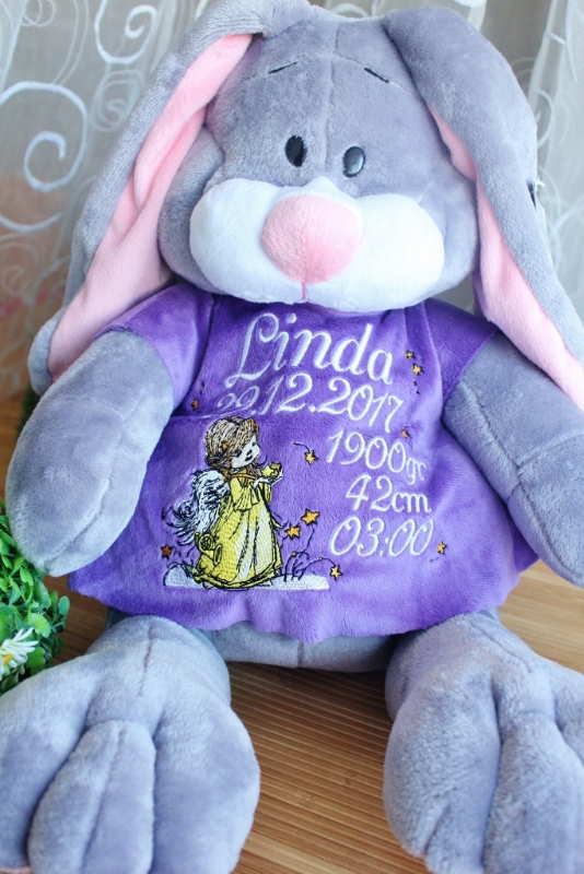 Bunny toy with embroidered dress